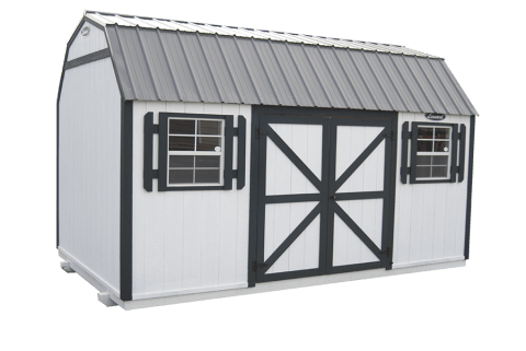White barn with black trim and metal roof