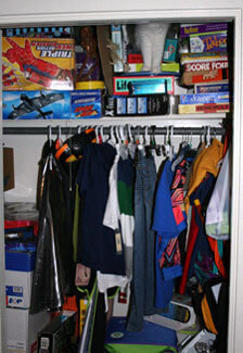 closet full of clothes and games