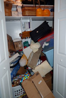 boxes stacked on top of each other in a closet