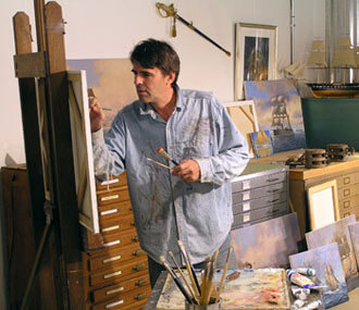 Man painting in shed studio