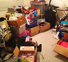 clutter room with cardboard boxes